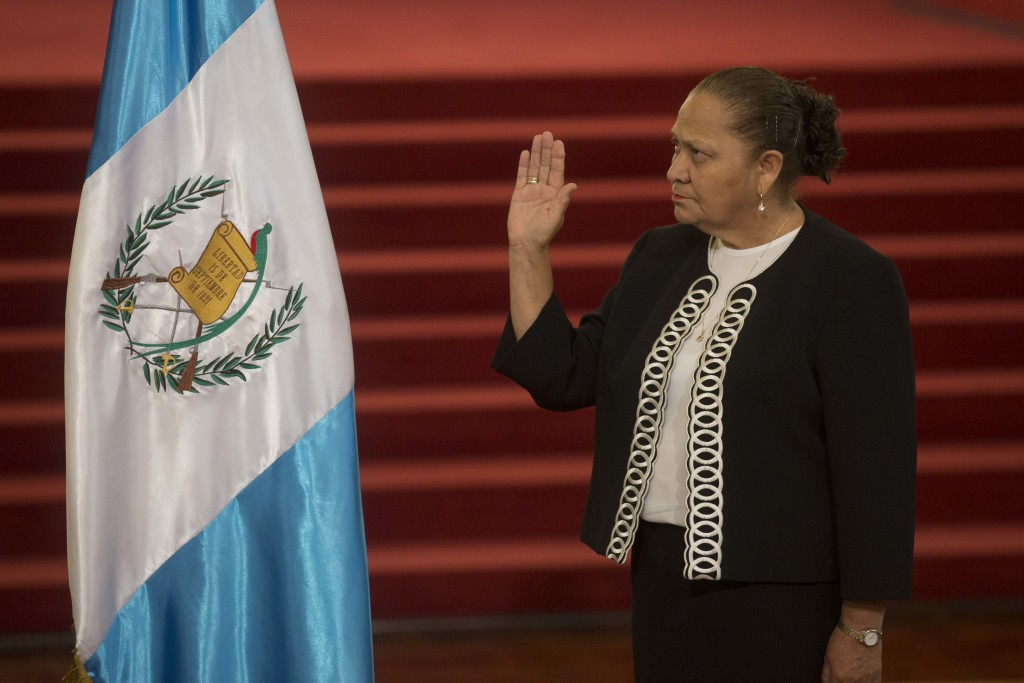 Maria Consuelo Porras Argueta raises her hand to be sworn-in as Attorney General at the National Palace in Guatemala City, Wednesday, May 16, 2018. Po