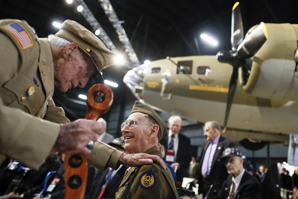 """Veterans gather for a private viewing of the Memphis Belle, a Boeing B-17 """"Flying Fortress,"""" at the National Museum of the U.S. Air Force, Wednesday,"""