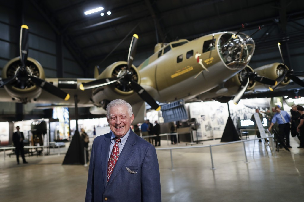 """Robert K. Morgan, Jr., son of the Memphis Belle pilot of the same name, walks past the Boeing B-17 """"Flying Fortress"""" during a private viewing at the N"""