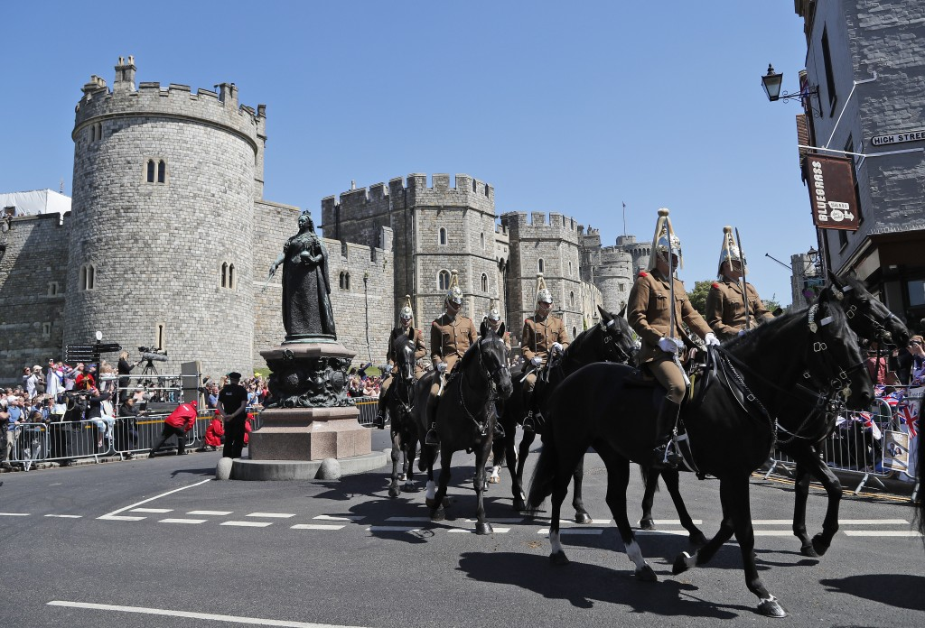 Mounted soldiers parade during a rehearsal for the procession of the upcoming wedding of Britain's Prince Harry and Meghan Markle in Windsor, England,