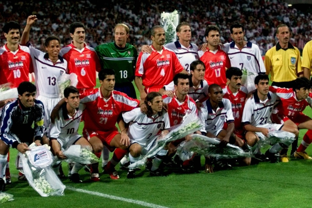 FILE - In this Sunday, June 21, 1998 file photo, US and Iranian players pose for a group photo before the start of their World Cup soccer match, at Ge