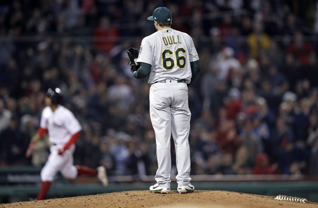 Oakland Athletics relief pitcher Ryan Dull (66) waits for Boston Red Sox's Xander Bogaerts to run the bases on a three-run home run during the sixth i