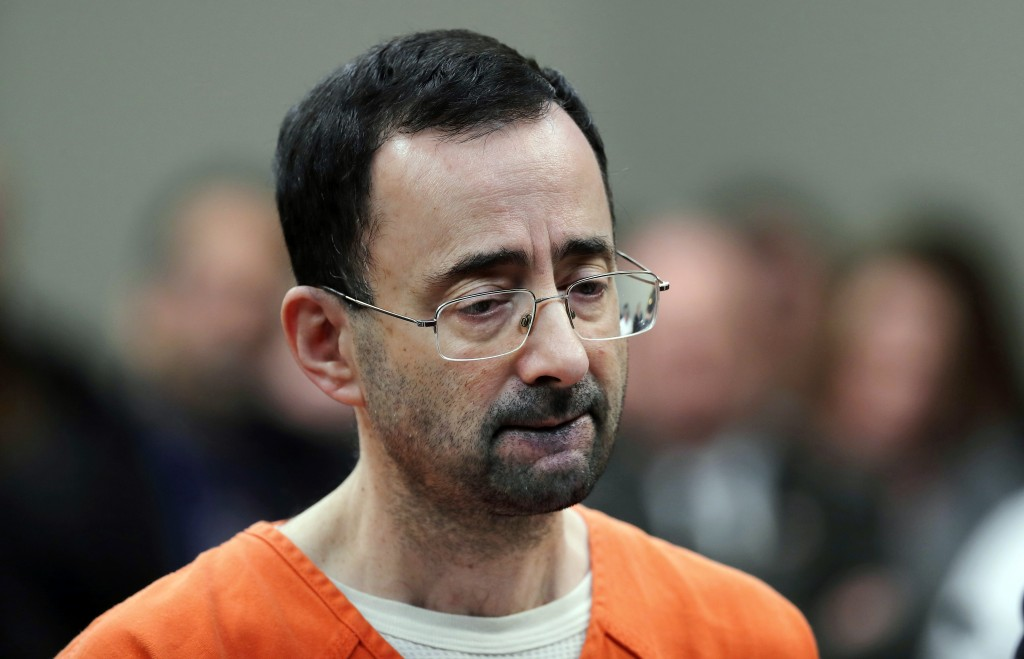 FILE - In this Nov. 22, 2017 file photo, Dr. Larry Nassar, 54, appears in court for a plea hearing in Lansing, Mich. Michigan State University announc