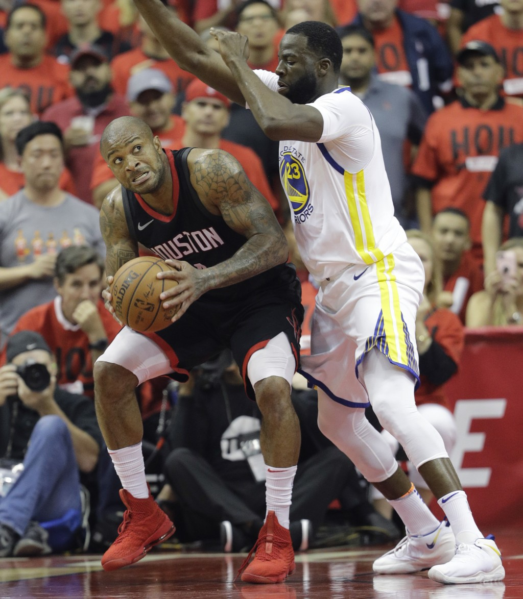 Houston Rockets forward P.J. Tucker, left, is pressured by Golden State Warriors forward Draymond Green (23) during the first half in Game 2 of the NB