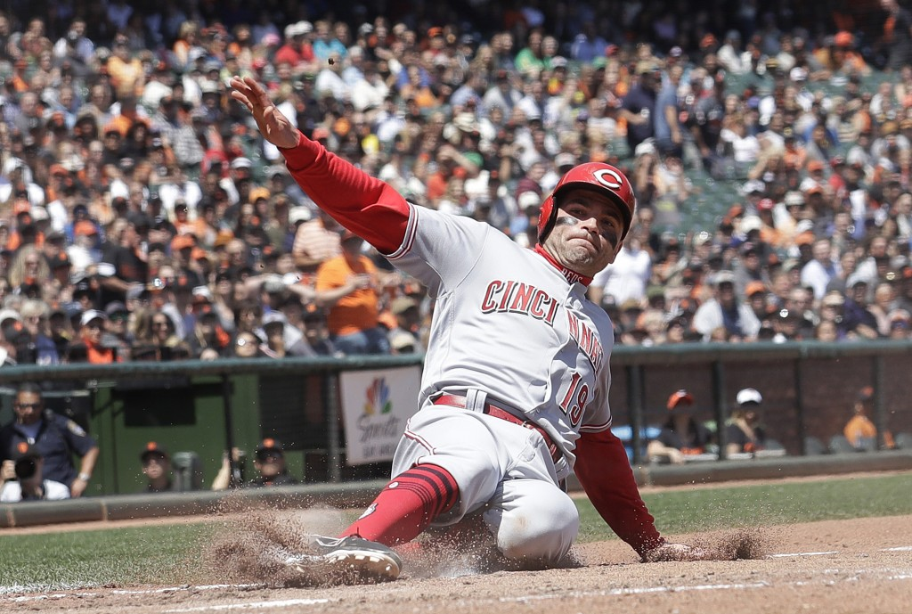 Cincinnati Reds' Joey Votto scores against the San Francisco Giants during the fifth inning of a baseball game in San Francisco, Wednesday, May 16, 20