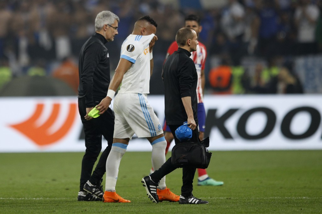 Marseille's Dimitri Payet walks off the pitch after sustaining an injury during the Europa League Final soccer match between Marseille and Atletico Ma