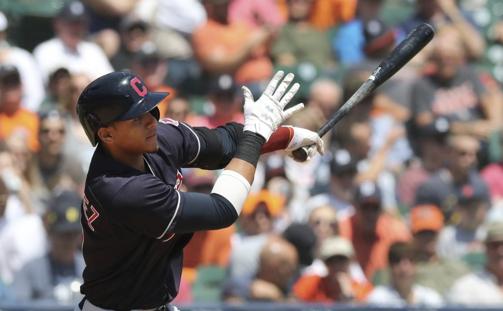 Cleveland Indians' Erik Gonzalez hits an RBI single during the fourth inning of a baseball game against the Detroit Tigers, Wednesday, May 16, 2018, i