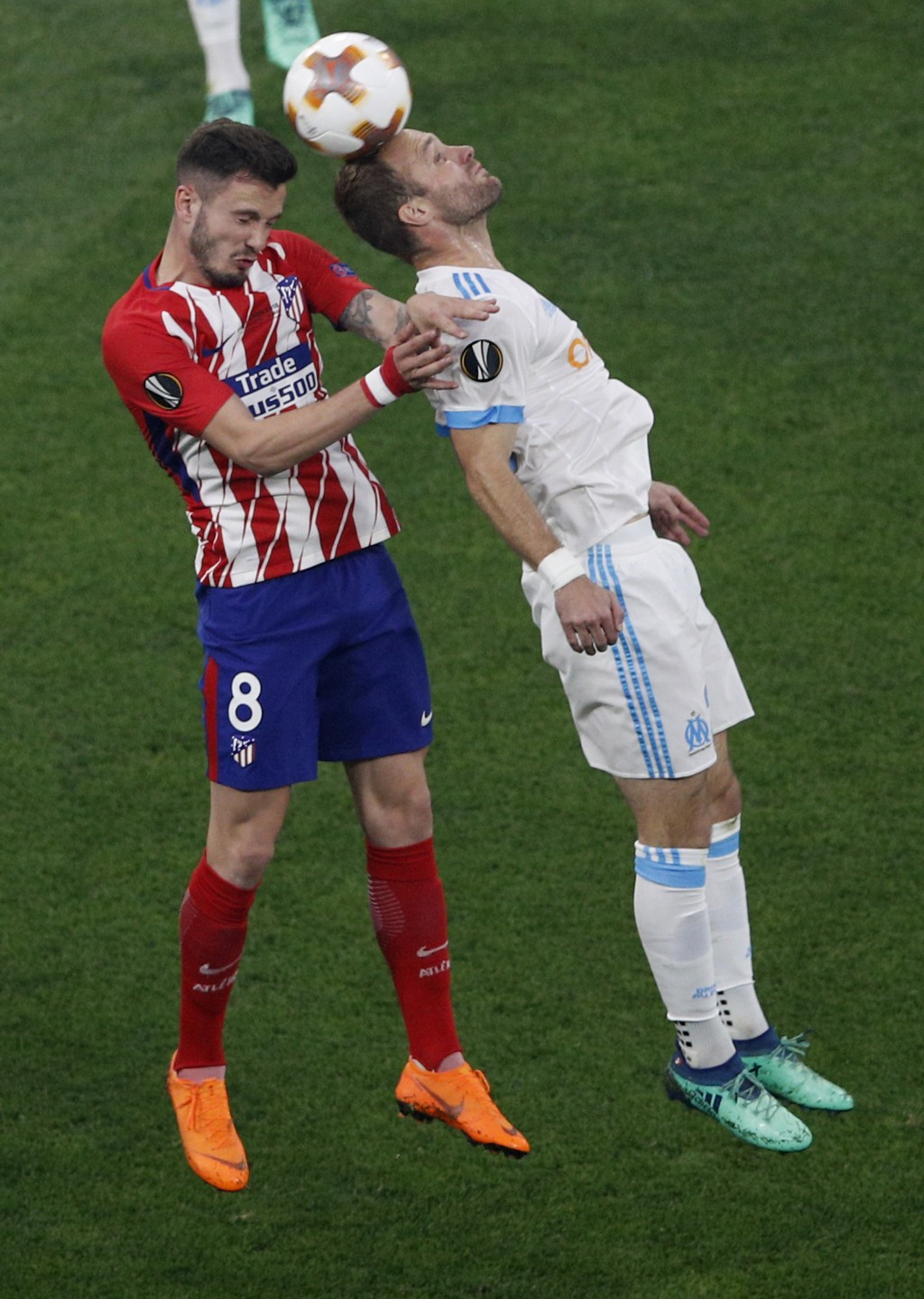 Atletico's Saul Niguez, left, fights to head the ball with Marseille's Valere Germain during the Europa League Final soccer match between Marseille an