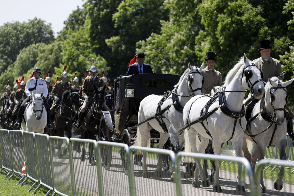A carriage procession drives along The Long Walk during a rehearsal for The Royal Wedding in Windsor, England, Thursday, May 17, 2018. Britain's Princ
