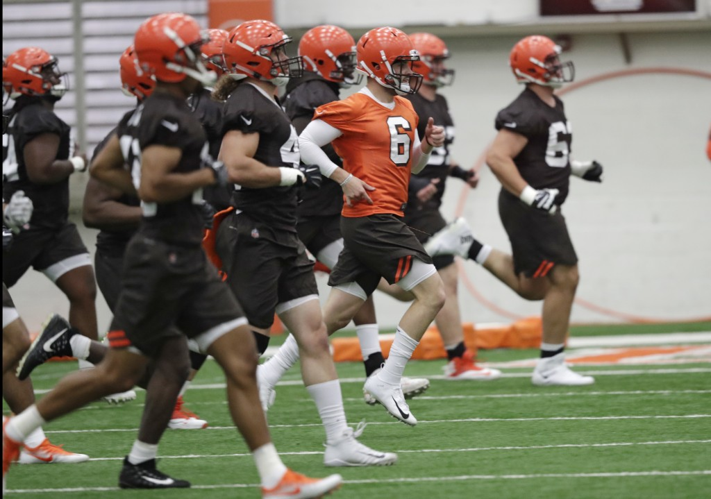 FILE - In this May 4, 2018, file photo, Cleveland Browns quarterback Baker Mayfield (6) runs a drill during rookie minicamp at the NFL football team's