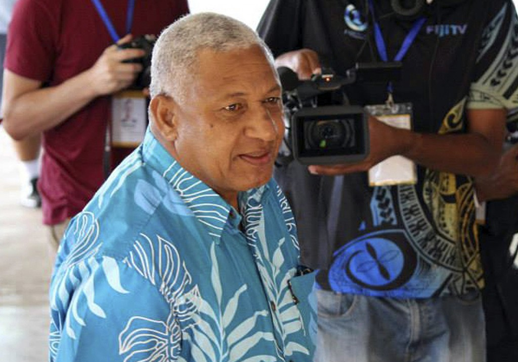 FILE - In this Sept. 17, 2014 file photo, Fiji's military ruler Voreqe Bainimarama arrives at a polling station to cast his vote in a national electio
