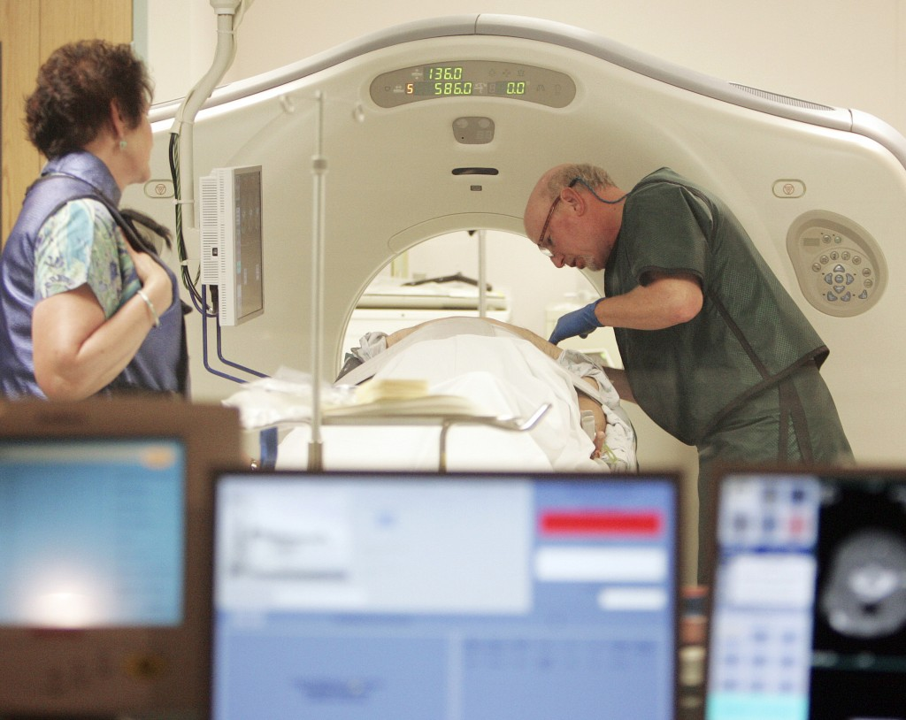 FILE - In this June 3, 2010, file photo, Dr. Steven Birnbaum works with a patient in a CT scanner at Southern New Hampshire Medical Center in Nashua,