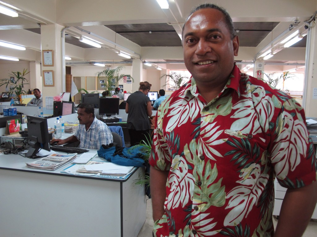 FILE - In this Nov. 6, 2013 file photo, Fiji Times newspaper editor Fred Wesley stands in the newsroom in Suva, Fiji. A judge in Fiji found an opinion