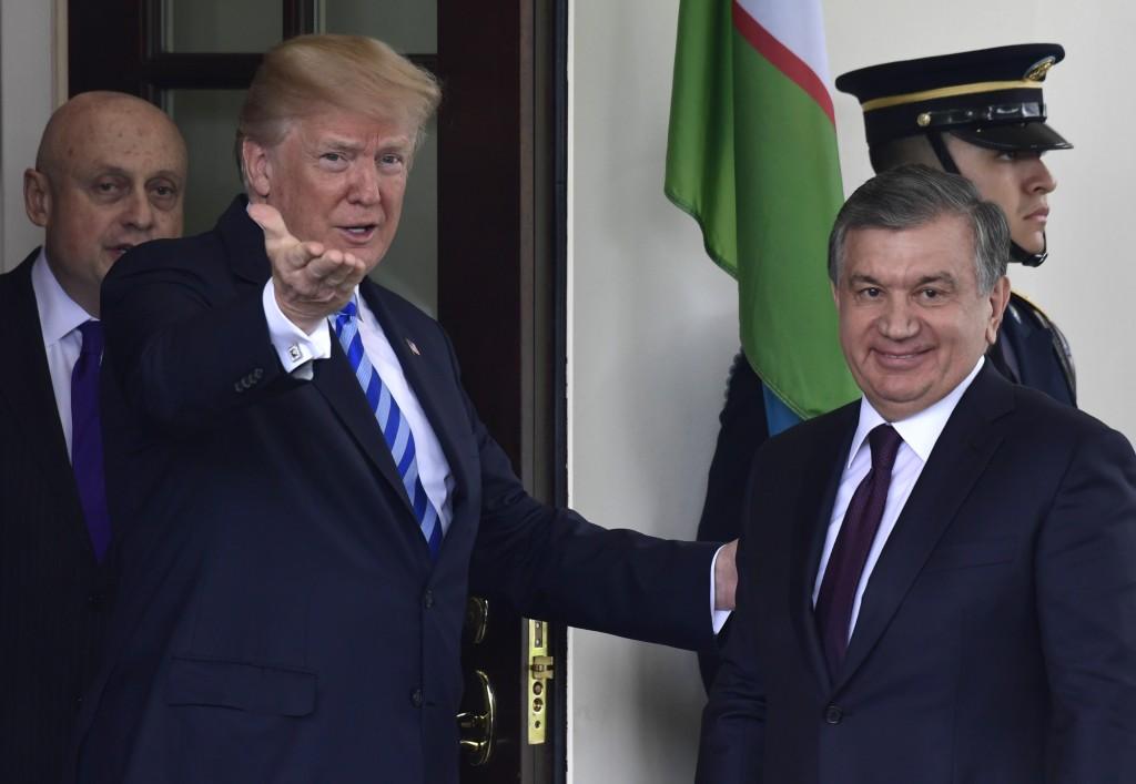 President Donald Trump greets Uzbek President Shavkat Mirziyoyev outside the West Wing of the White House in Washington, Wednesday, May 16, 2018. (AP