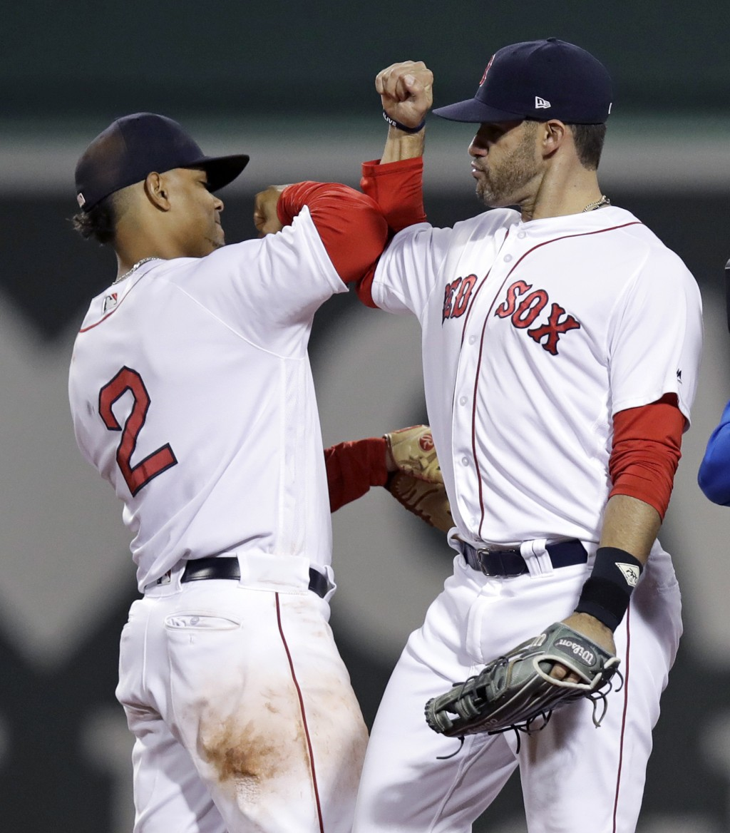 Boston Red Sox right fielder J.D. Martinez, right, and shortstop Xander Bogaerts celebrate after the Red Sox defeated the Oakland Athletics 6-4 during
