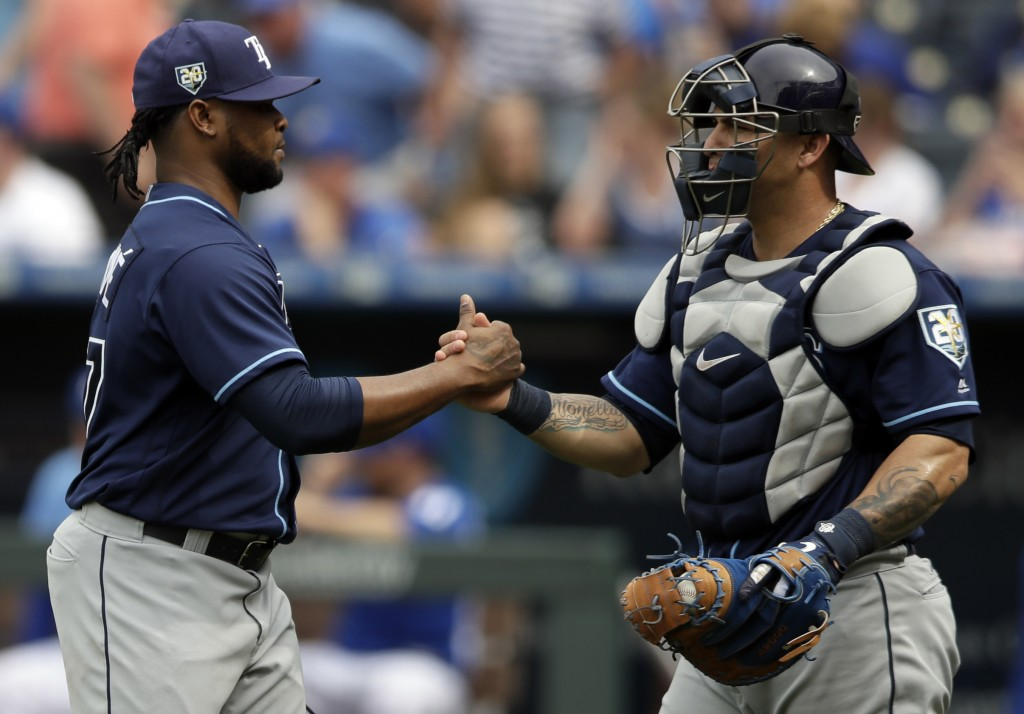 Tampa Bay Rays relief pitcher Alex Colome, left, is congratulated by catcher Wilson Ramos, right, following a baseball game against the Kansas City Ro