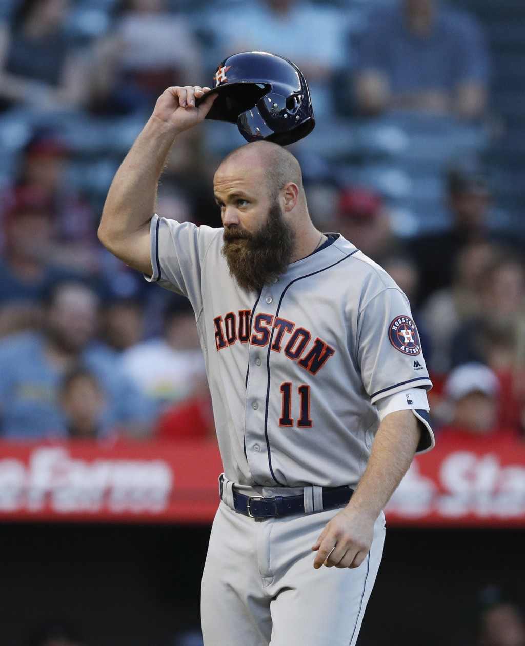 Houston Astros' Evan Gattis celebrates his two-run home run during the second inning of the team's baseball game against the Los Angeles Angels on Wed...