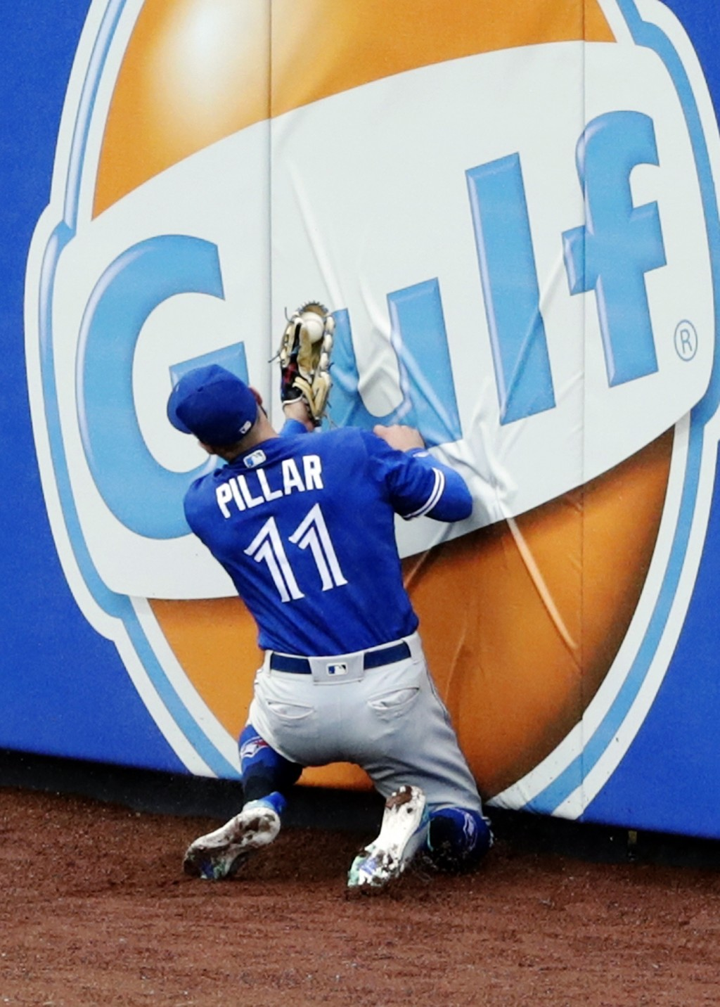 Toronto Blue Jays center fielder Kevin Pillar catches a ball hit by New York Mets' Michael Conforto for an out as he hits the wall during the second i