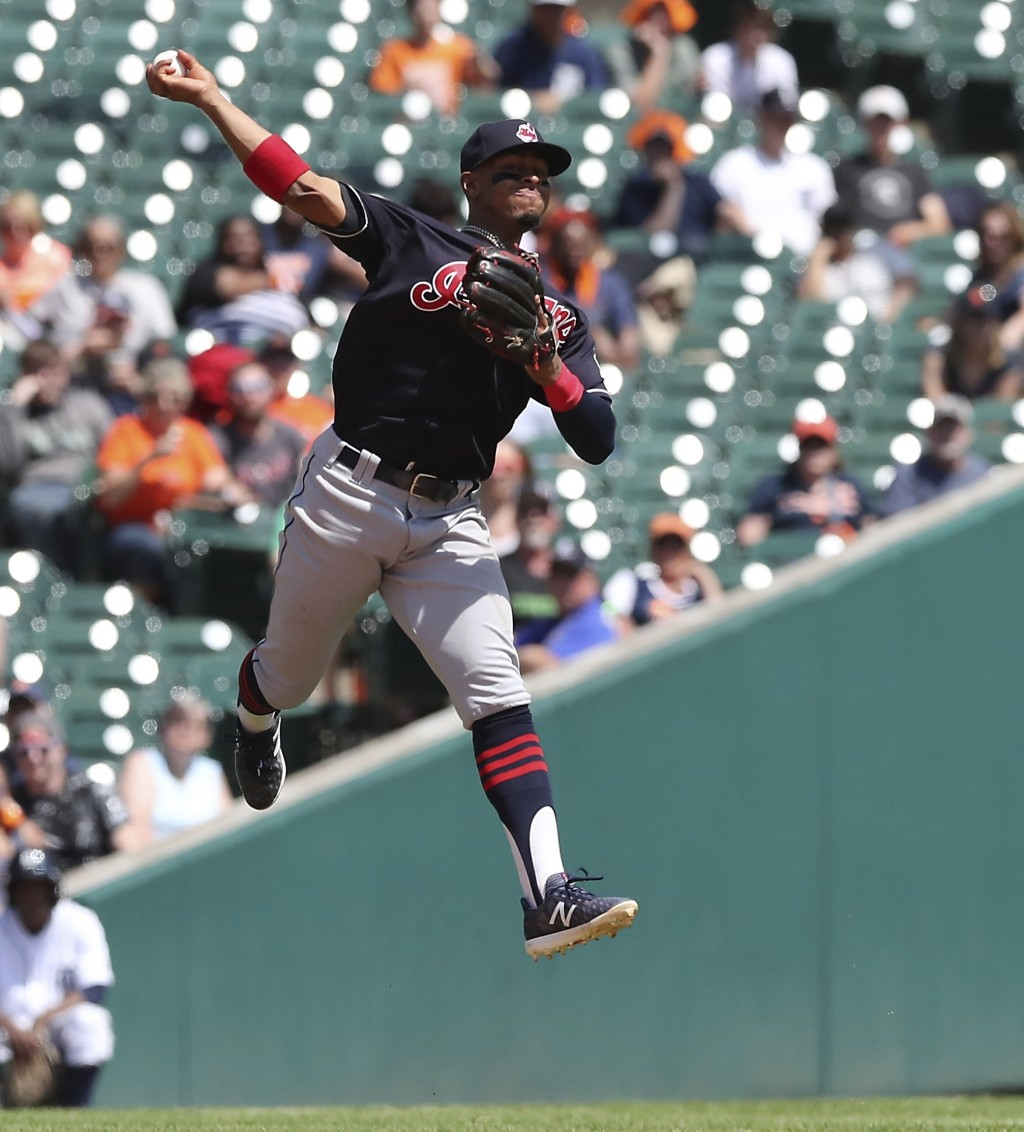 Cleveland Indians shortstop Francisco Lindor is unable to make a leaping throw to put out Detroit Tigers' Jose Iglesias at first during the sixth inni