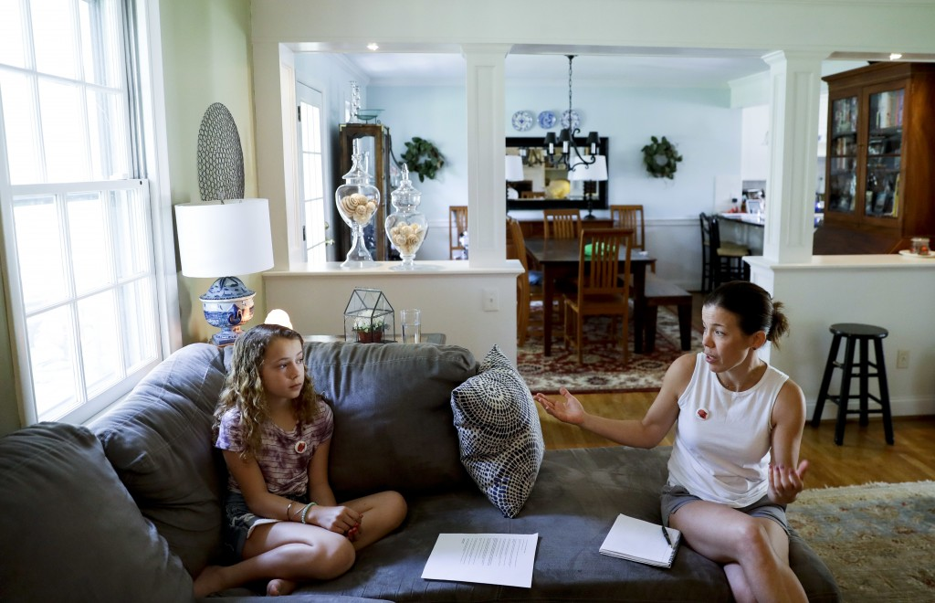 In this Thursday, May 3, 2018 photo, Sandy Nissenbaum, right, and her daughter, Nora Nissenbaum, 12, talk during an interview with The Associated Pres