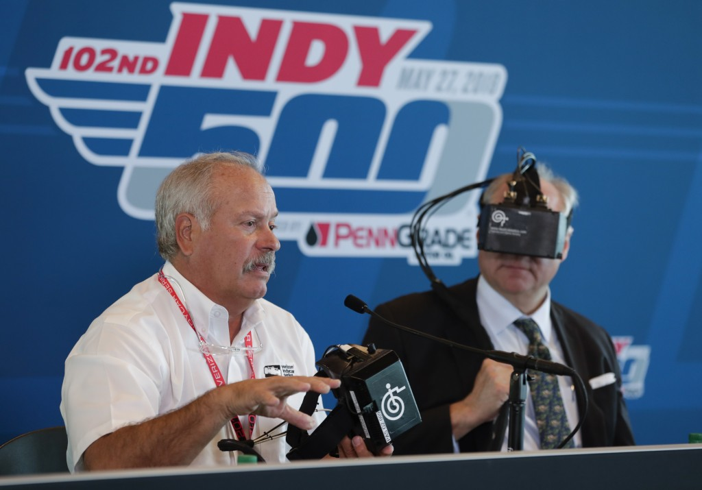 Dr. Terry Trammell, IndyCar safety consultant, left, describes the I-Portal Portable Assessment System being worn by J. Howison Schroeder, president a