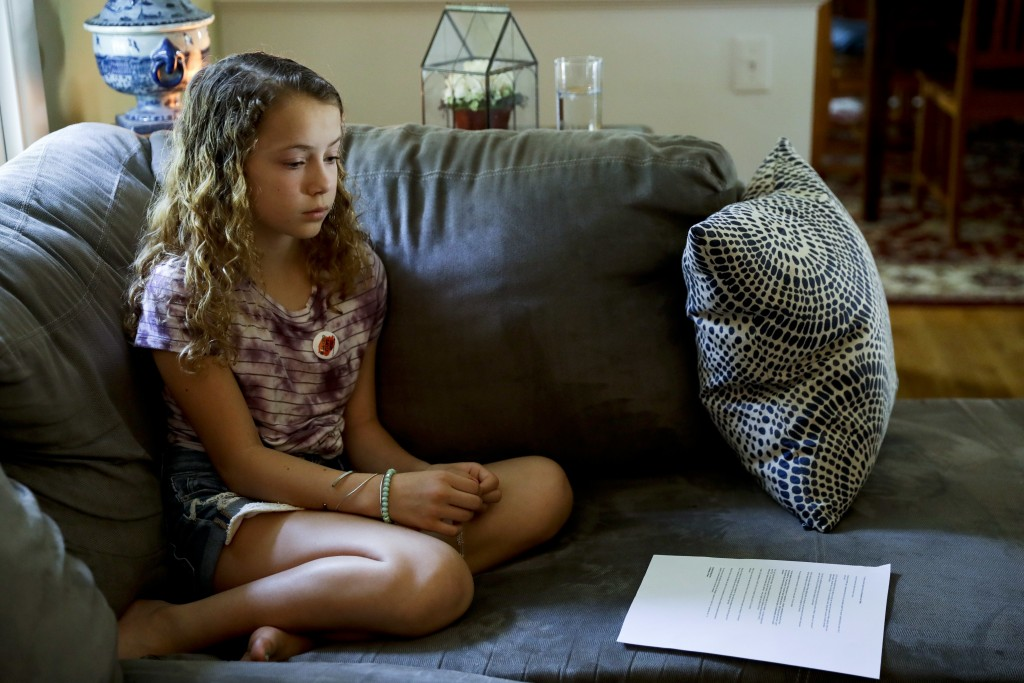 In this Thursday, May 3, 2018 photo, Nora Nissenbaum, 12, pauses during an interview with The Associated Press in Wayne, Pa. The case of a suburban Ph