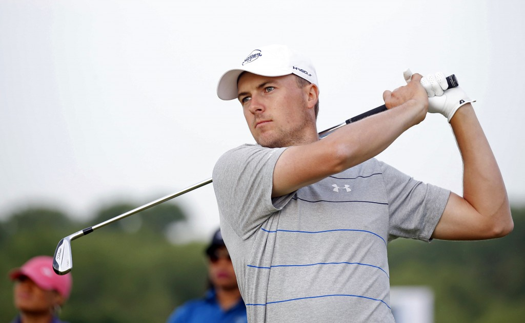 Jordan Spieth watches his ball after hitting from the fairway on the first hole during the pro-am at the AT&T Byron Nelson golf tournament at Trinity