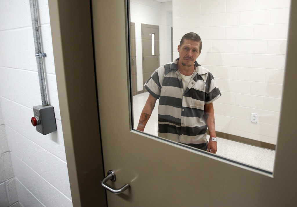 In this Tuesday, May 1, 2018 photo, inmate Richard Walls arrives at an attorney interview room at Richmond City Jail in Richmond, Va. A federal appeal