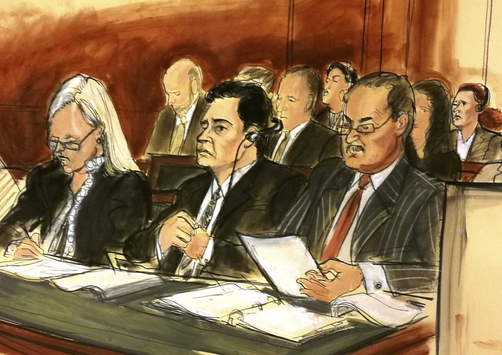 In this courtroom sketch Mehmet Hakan Atilla, second from left, listens to the judge during his sentencing, flanked by his attorneys Cathy Fleming, le