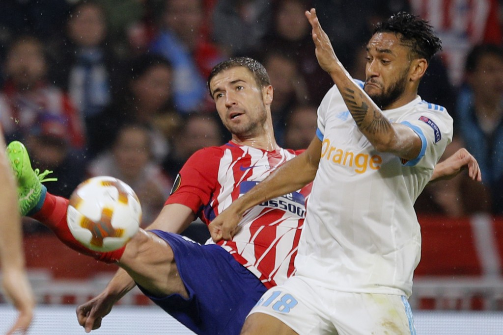 Atletico's Gabi, left, and Marseille's Jordan Amavi vie for the ball during the Europa League Final soccer match between Marseille and Atletico Madrid