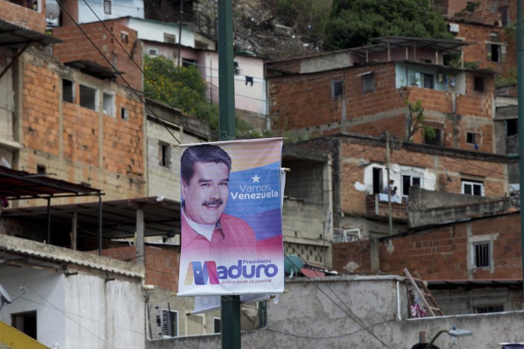 A presidential election campaign sign of Venezuelan President Nicolas Maduro hangs in the neighborhood of San Agustin in Caracas, Venezuela, Wednesday