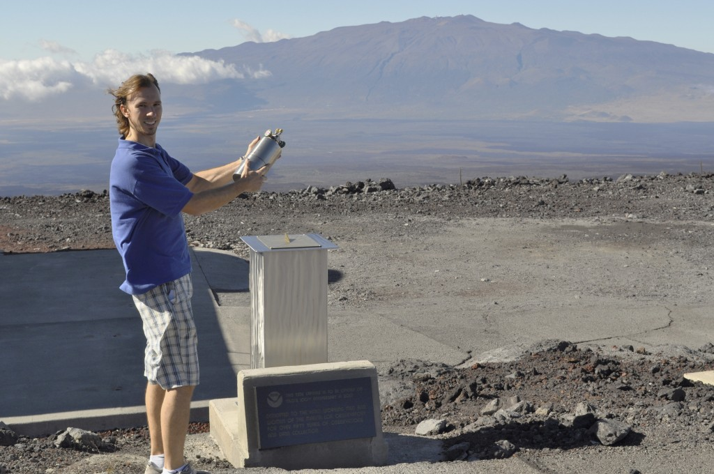 This undated photo provided by NOAA in May 2018 shows Mauna Loa Observatory scientist Aidan Colton, a NOAA employee who fills flasks and maintains ins
