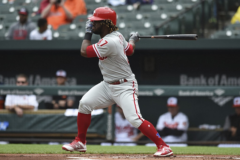 Philadelphia Phllies' Odubel Herrera follows through on a single against the Baltimore Orioles in the first inning of baseball game, Wednesday, May 16
