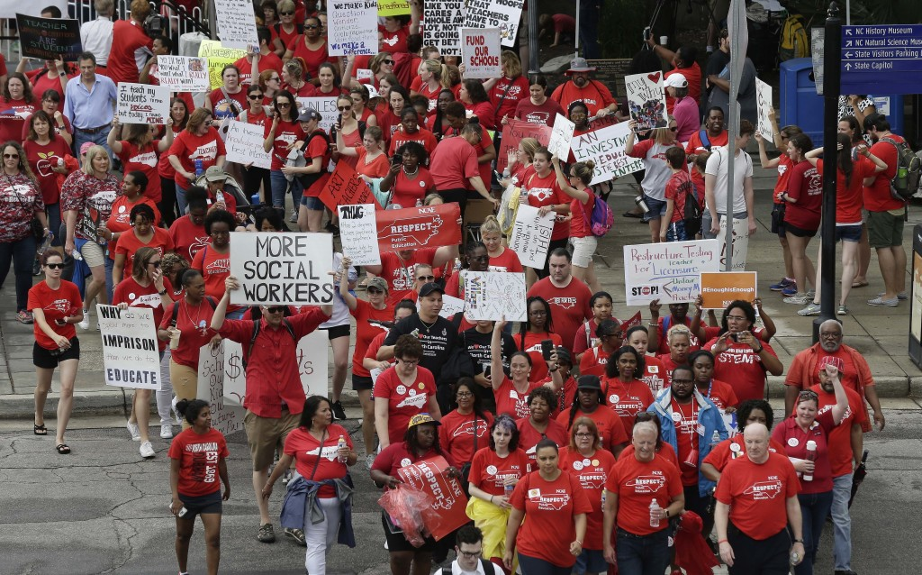 Participants make their way towards the Legislative Building during a teacher's rally at the General Assembly in Raleigh, N.C., Wednesday, May 16, 201