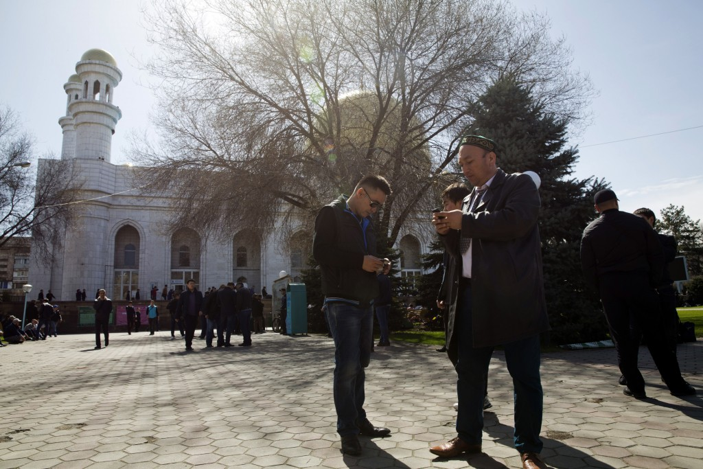 In this March 30, 2018, photo, Omir Bekali, front right, prepares to pray at a mosque in Almaty, Kazakhstan. Since 2016, Chinese authorities in the he