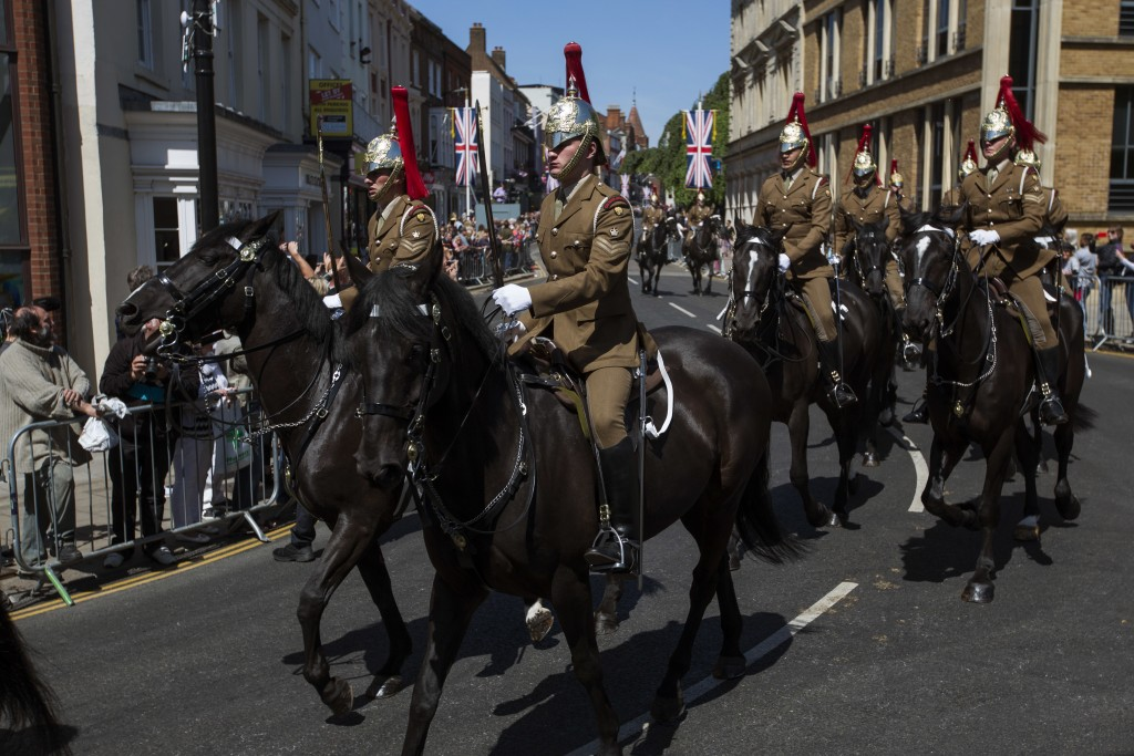 Members of the armed forces ride horses along the streets of Windsor, England during a rehearsal for the procession of the upcoming wedding of Britain