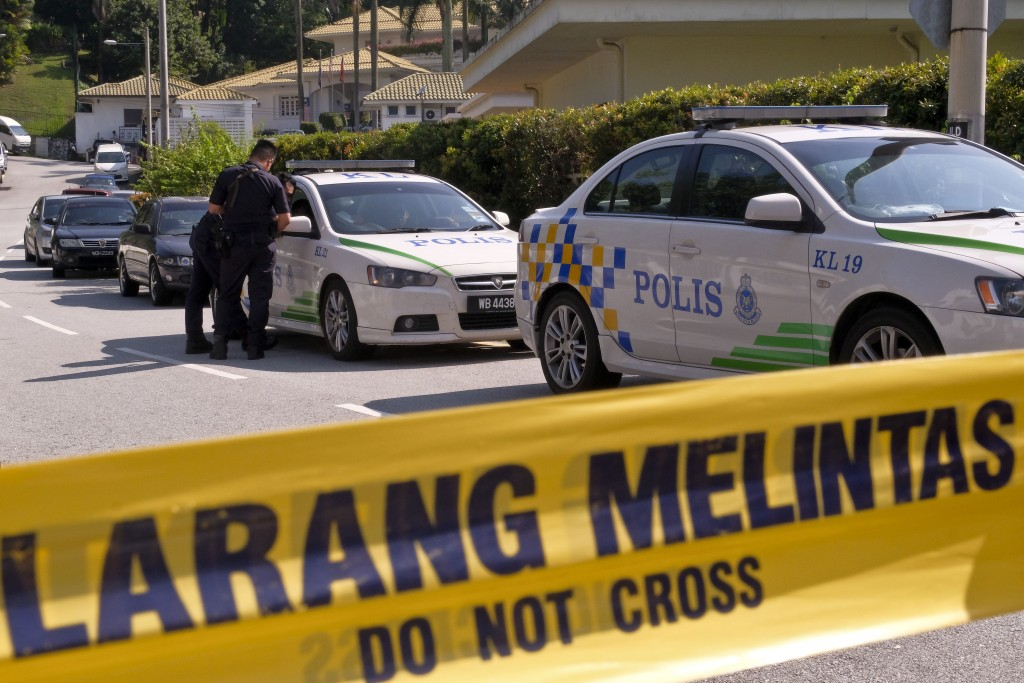 An entrance road to the resident of former Malaysian Prime Minister Najib Razak is cordoned off in Kuala Lumpur, Malaysia, Thursday, May 17, 2018. Mal