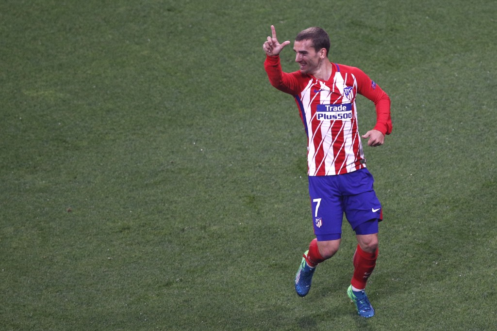 Atletico 's Antoine Griezmann's celebrates his side opening goal during the Europa League Final soccer match between Marseille and Atletico Madrid at