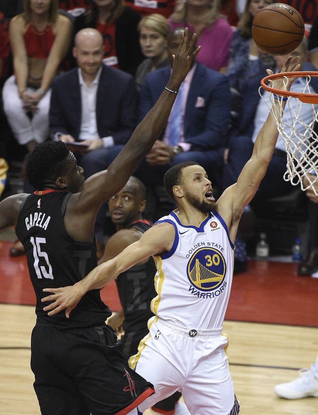 Golden State Warriors guard Stephen Curry (30) drives to the basket as Houston Rockets center Clint Capela (15) defends during the first half of Game
