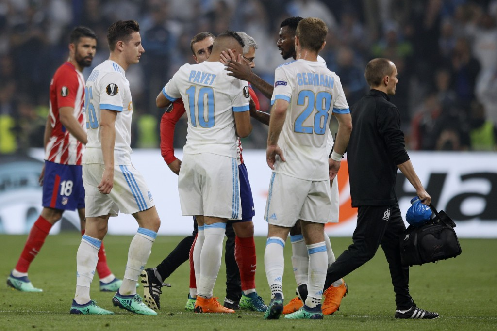 Teammates hugs Marseille's Dimitri Payet, center, as he walks off the pitch after sustaining an injury during the Europa League Final soccer match bet