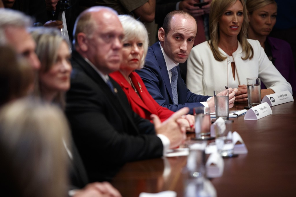 White House senior adviser Stephen Miller listens to President Donald Trump speak during a roundtable on immigration policy in California, in the Cabi...