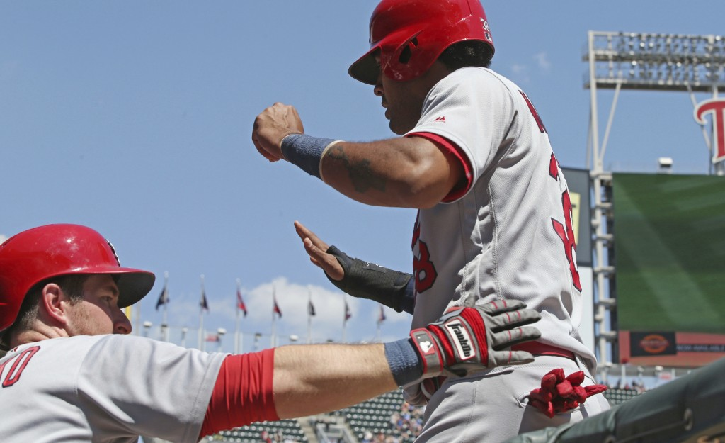 St. Louis Cardinals' Jose Martinez, right, is congratulated by Jedd Gyorko after he scored on a double by Paul DeJong off Minnesota Twins pitcher Tayl...