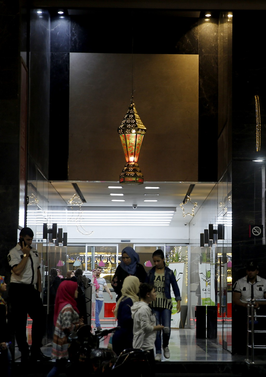Palestinians shop for traditional Ramadan lanterns for the month of Ramadan, at the main market in Gaza City, Wednesday, May 16, 2018. Muslims through...