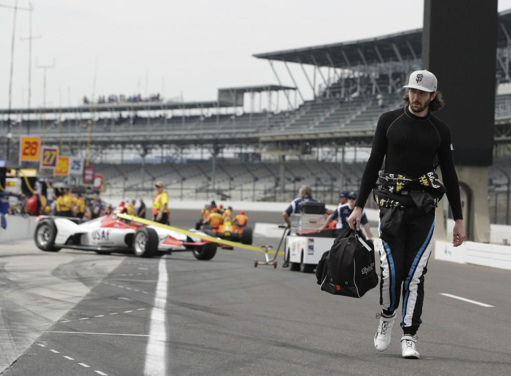 JR Hildenbrand walks down pit road before a practice session for the IndyCar Indianapolis 500 auto race at Indianapolis Motor Speedway in Indianapolis