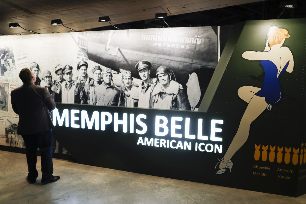 "Visitors gather for a private viewing of the Memphis Belle, a Boeing B-17 ""Flying Fortress,"" at the National Museum of the U.S. Air Force, Wednesday,"