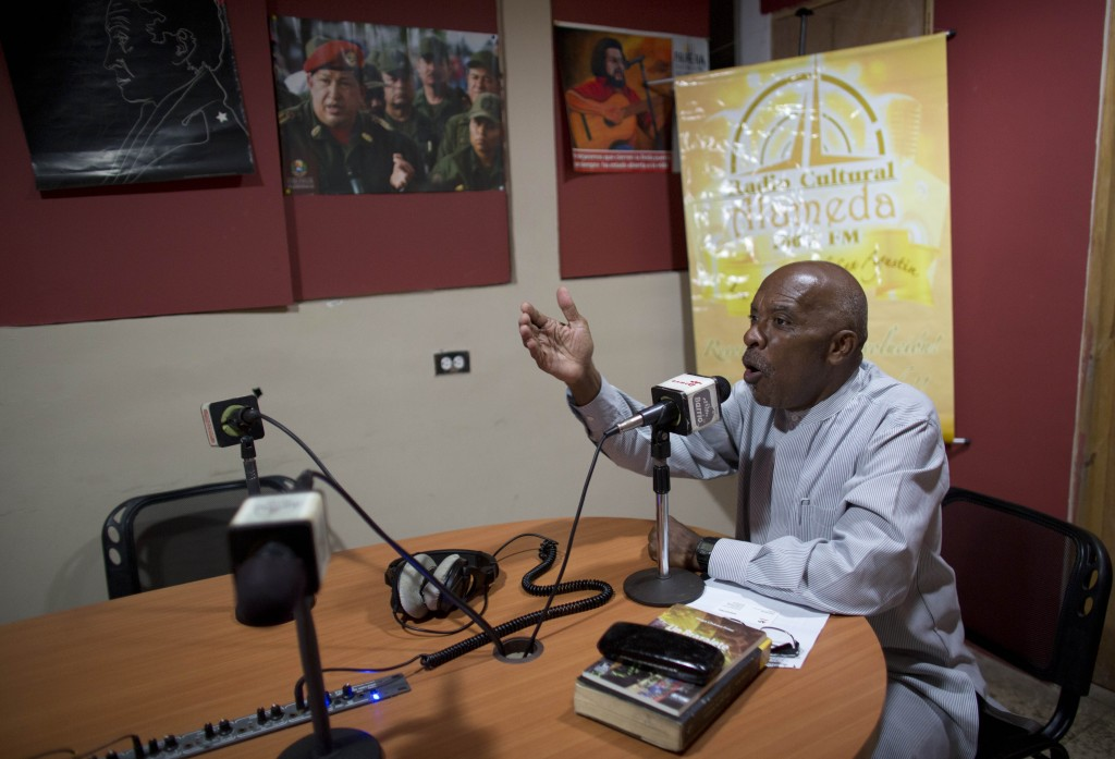 In this April 6, 2018 photo, Hector Madera hosts his two-hour pro-government radio talk show in the neighborhood of San Agustin in Caracas, Venezuela.