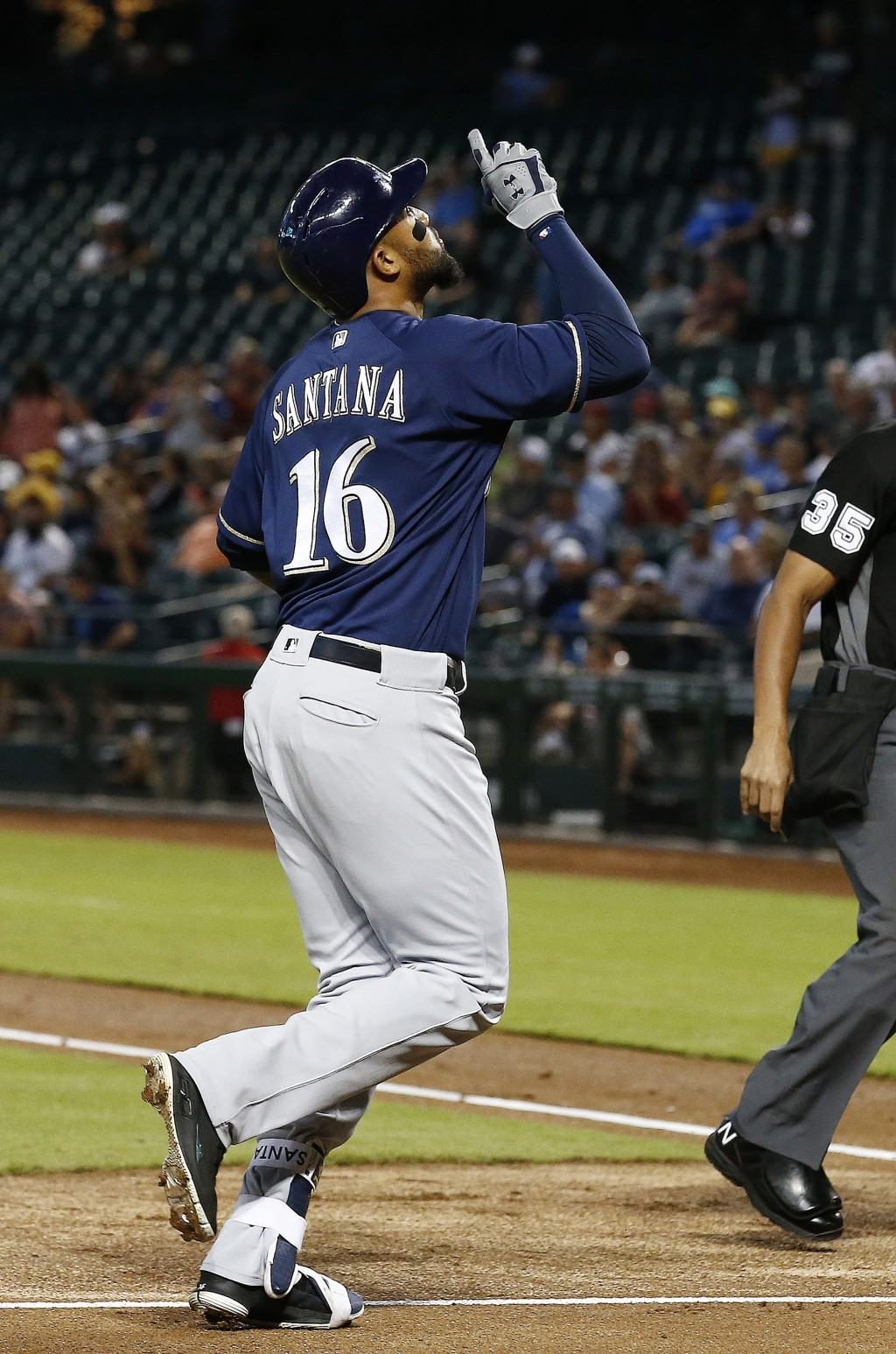 Milwaukee Brewers' Domingo Santana points to the sky after his home run against the Arizona Diamondbacks during the first inning of a baseball game We