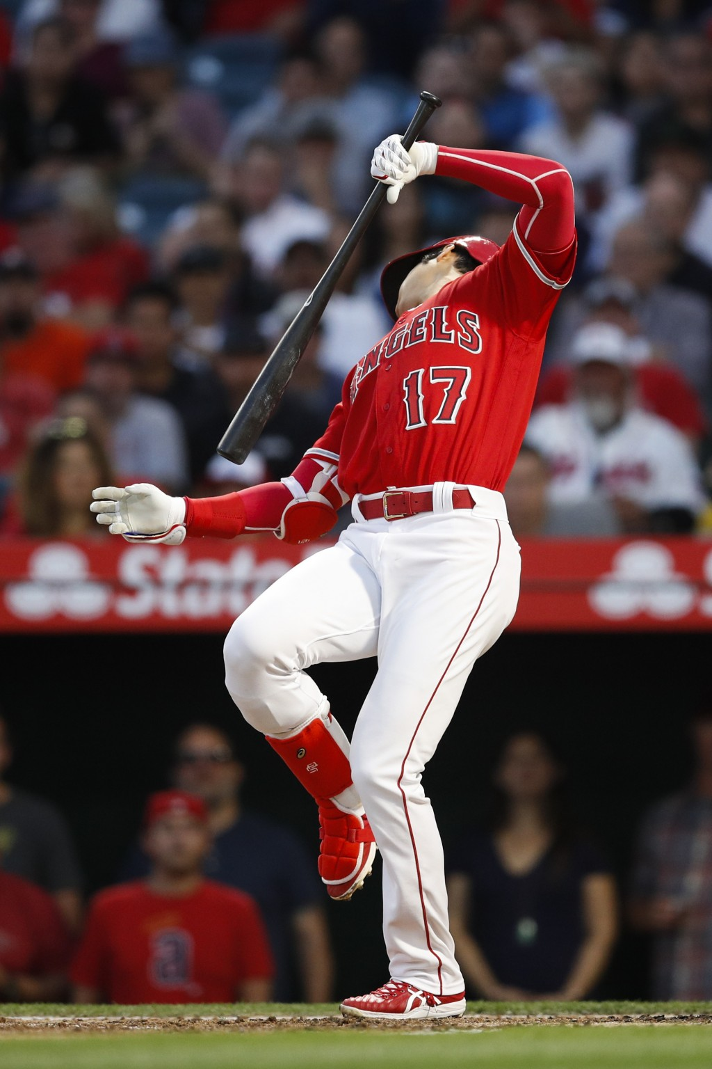 Los Angeles Angels' Shohei Ohtani, of Japan, loses balance after swinging at a pitch during the fourth inning of the team's baseball game against the ...