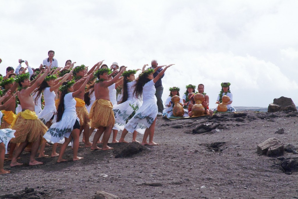 FILE - In this April 23, 2003 file photo, members of the Hula Na Mamo O Pu'uanahulu hula school perform a hula for Pele, the Hawaiin goddess of the vo