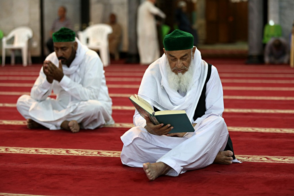 Muslim worshippers read the Quran, Islam's holy book, at Abdul-Qadir al-Gailani mosque in Baghdad, Iraq, Wednesday, May 16, 2018. Muslims throughout t...